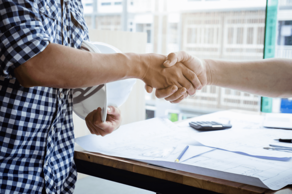 AE Firm Employees Shaking Hands